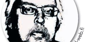 Mustavalkoinen kuva Juha Keltistä, jolla on silmälasit ja lyhyt parta.